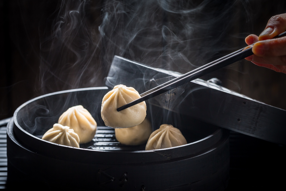 dumplings in a black container